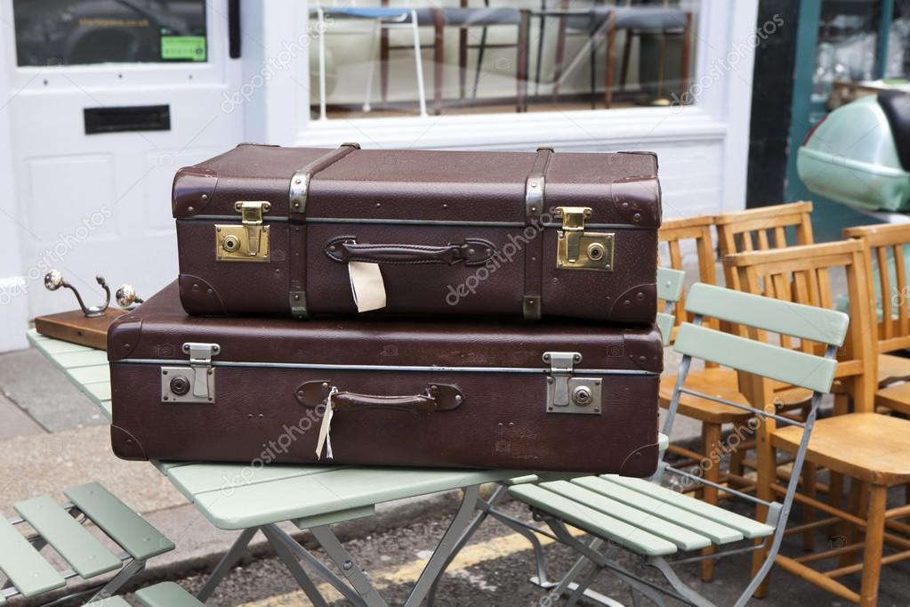 Suitcases near vintage shop at Portobello Market, in Notting Hill district,  largest antiques market in UK, famous tourist attractions, on AUG 16, 2015,  ...