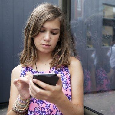 American latin teen girl with smartphone