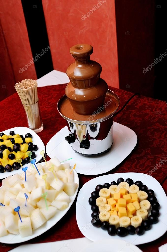 Chocolate Fountain And Fruits At Wedding Reception Stock Photo