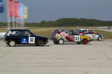 Three Yugo Cars