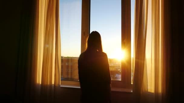 woman in hotel looking on airplane in window, steadicam shot