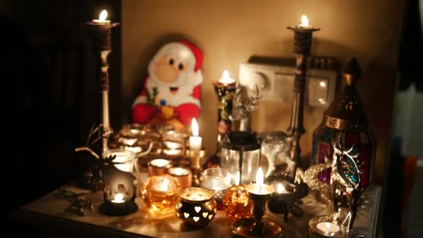 Burning candle with santa claus, christmas decoration
