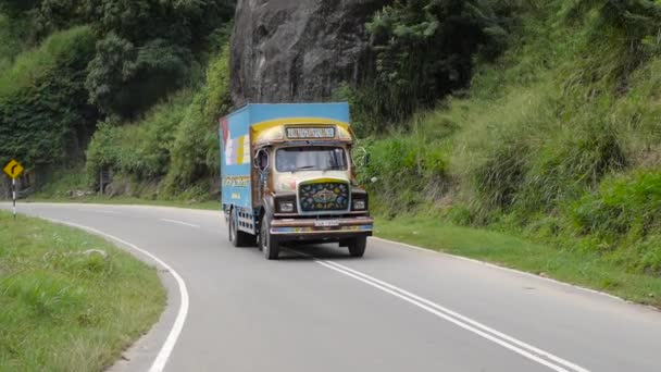 Truck driving very slow to the top of the mountain, Sri Lanka