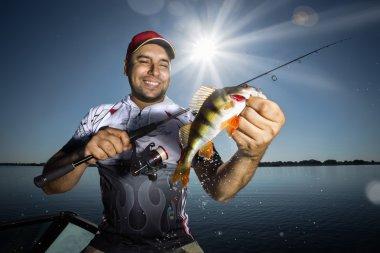 Angler with perch