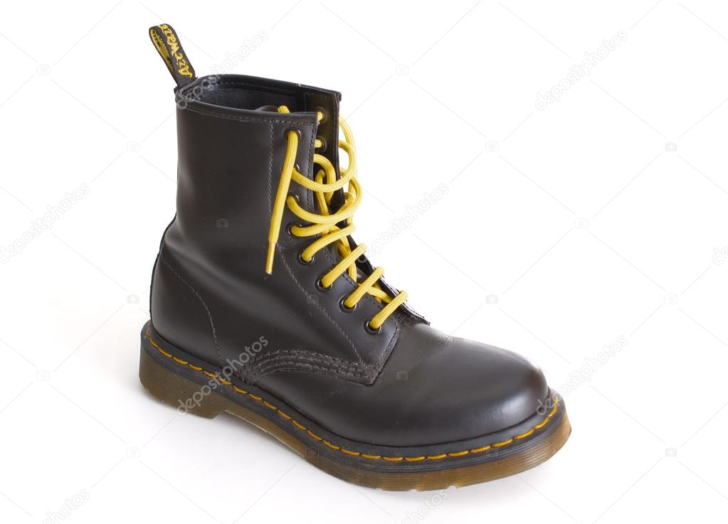 eb48acc70ddf8 TEL AVIV, ISRAEL - SEPT 28, 2014: A Doc Martens 8 eyelet 8 inch classic  unisex black lace-up fashion combat boot with yellow laces — Photo by dnaveh