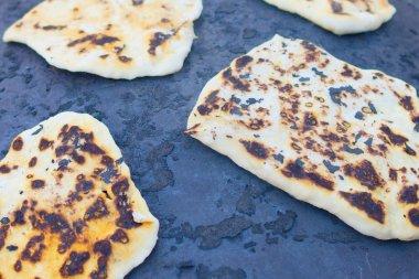 Pita bread baking on a Saj or Tava