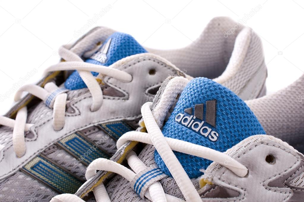5012691baf NEW YORK - May 22, 2015: Adidas running shoes - sneakers - trainers, in  gray and blue, showing the Adidas logo and famous three stripes -  illustrative ...