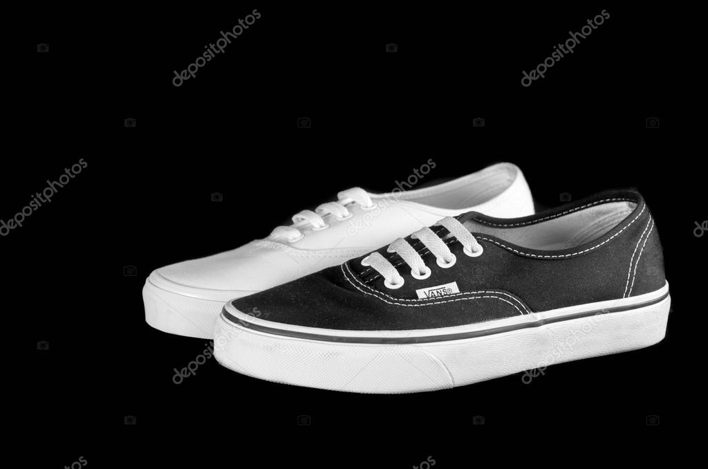 Black and White Vans sneakers isolated on black