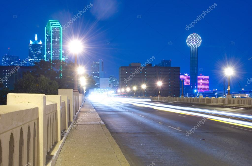 downtown dallas texas skyline at night from the commerce bridge