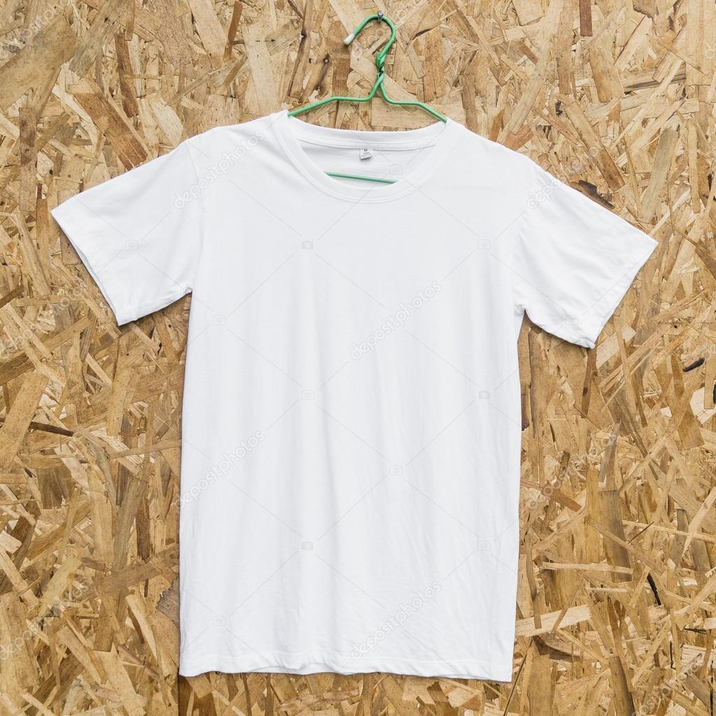 blank white t shirt on wood background stock photo jes2uphoto