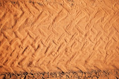 Top view of wheel tracks on dirt