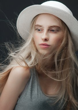 blonde woman in white hat