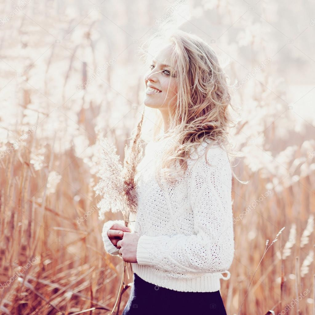 blonde girl in a field