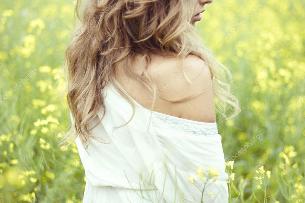 blond girl in a field