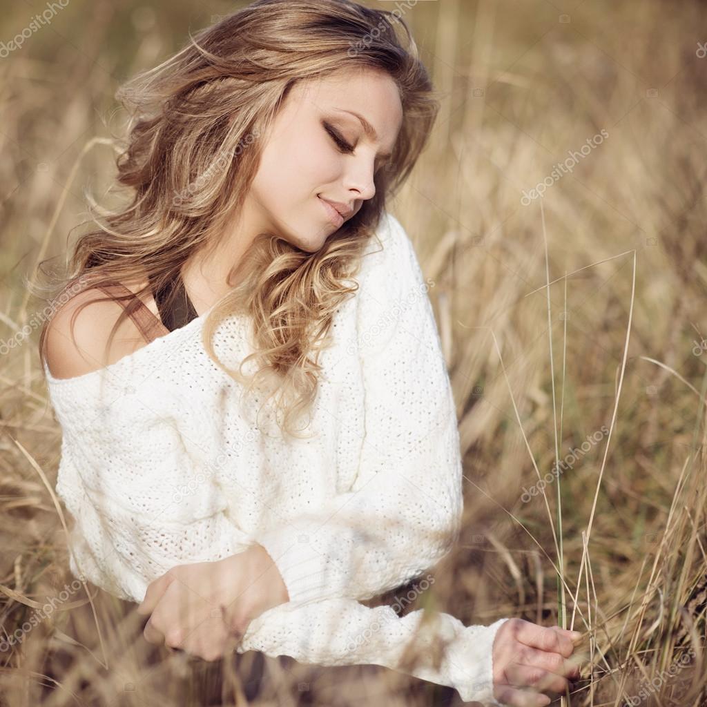 Girl in an autumn field
