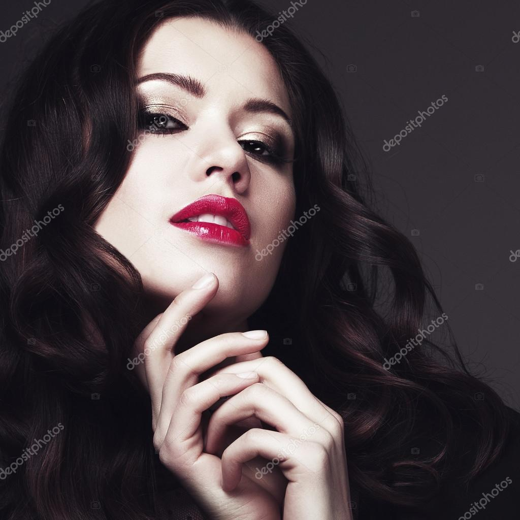 Black dress with red lipstick - Girl In A Black Dress And Red Lipstick Stock Photo 81971270