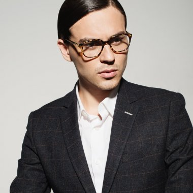 man  in a suit  with a thoughtful look