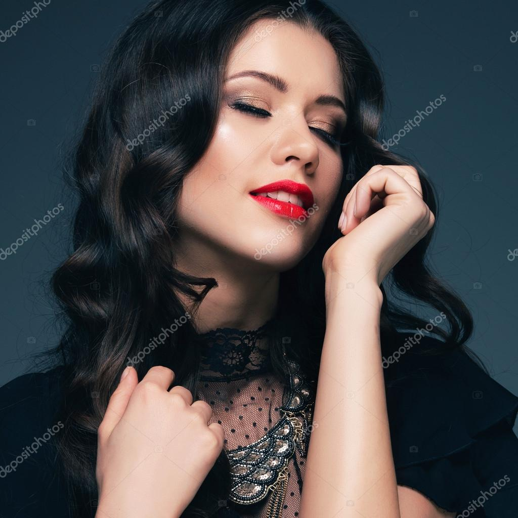 Black dress lipstick - Girl In A Black Dress And Red Lipstick Stock Photo 81989078