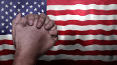 Photo A hand praying with Flag of USA as background. Grunge, depressing look. Can represent adversity, crisis, Christian or Catholic prayer, forgiveness, worship or plea in country. 3d illustration