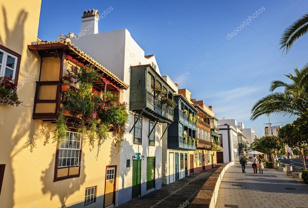 famous houses with colorful balconies on the waterfront of santa cruz in the early morning photo by natap