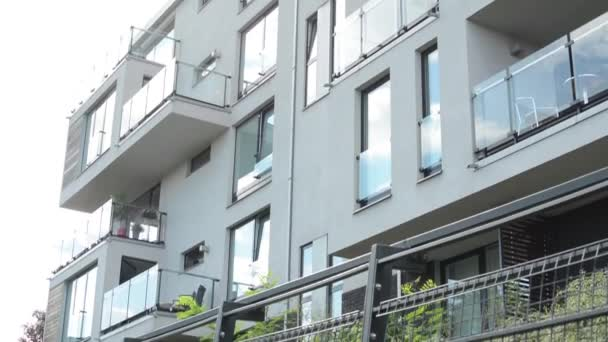 Modern building - balcony - windows - sky - fence with nature