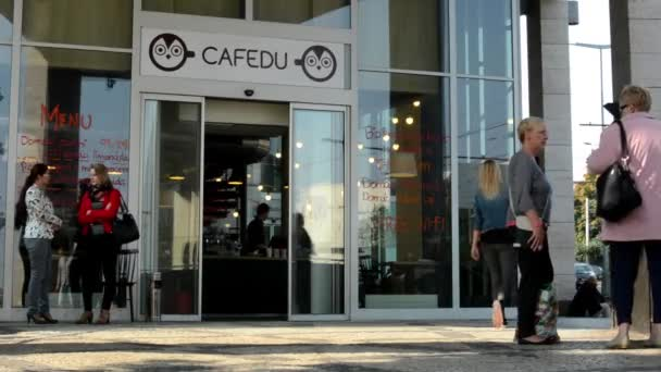 Exterior of coffee house with people (stand outside)