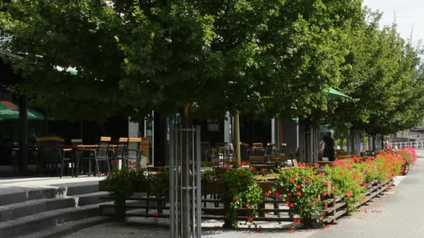 Outdoor furniture - restaurant exterior - with nature (flowers and trees)