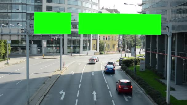 Traffic signs - green screen - passing cars - modern buildings with trees