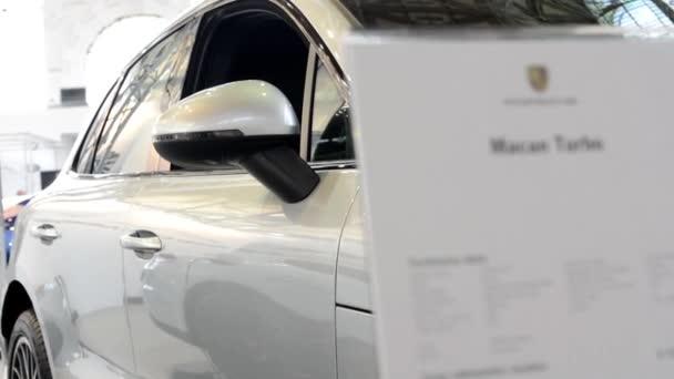 Porsche Macan Turbo SUV car (exterior) and information board