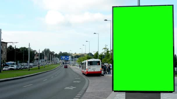 Billboard in the city near road and buildings - green screen - people with cars - nature and bus stop