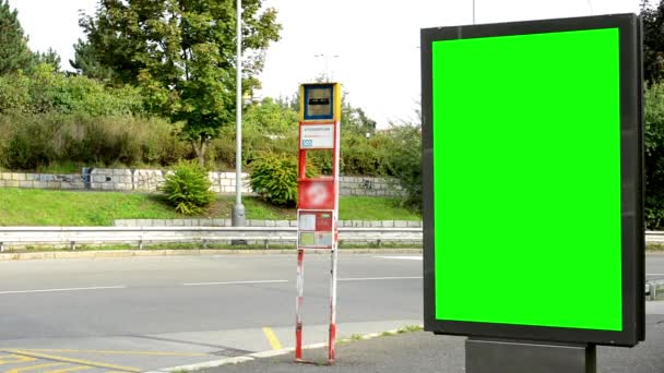 Billboard in the city near road - green screen - cars and people - bus stop