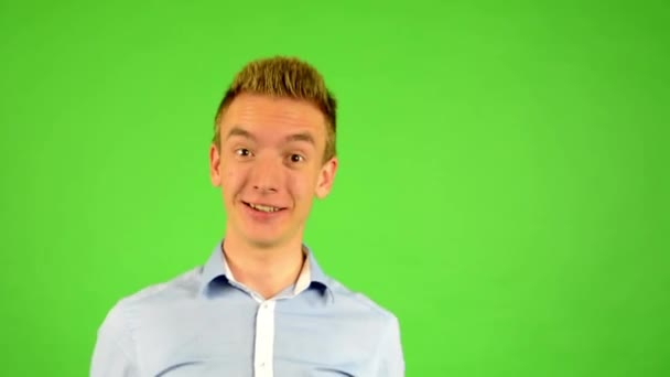 Man - green screen - portrait - man welcomes people - man invites people with hands