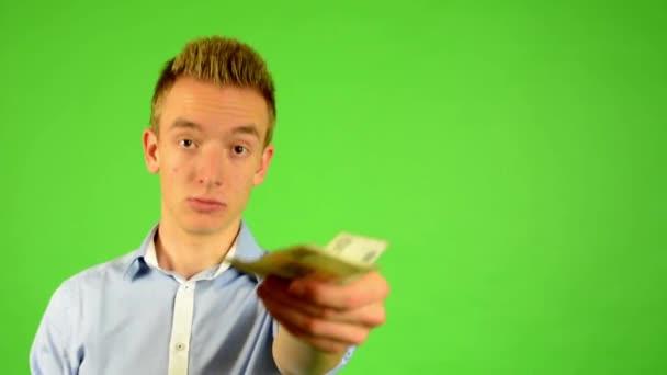 Man - green screen - portrait - man offers money (czech crown)