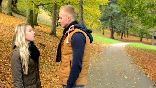 Woman hits man (slap in the face) - unhappy couple - couple argue - autumn park (nature)