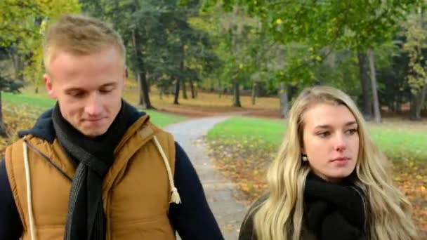 Young model couple in love - autumn park(nature) - couple (man and woman) walking in park - couple kiss (passionate kiss) - happy couple - couple walk and then kiss