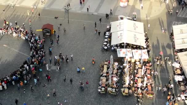 People walking on the street (square) - aerial - restaurant (outdoor seating)
