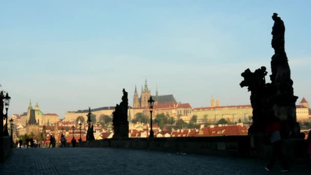 Charles bridge with people - sunrise - city - buildings with statues - Prague castle (Hradcany)