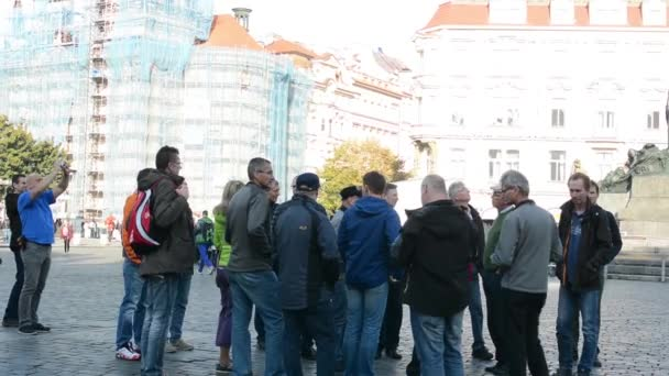 Group of tourists in city (square)