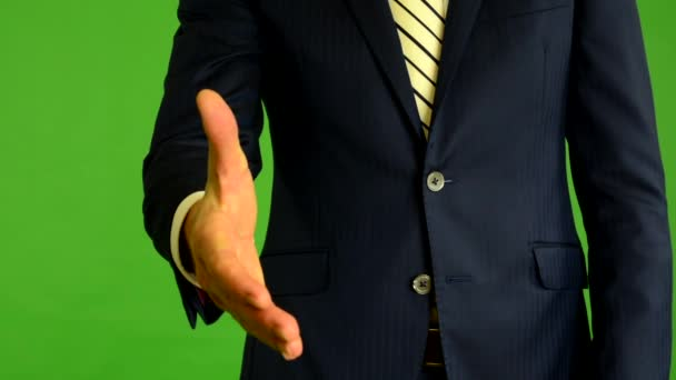 Business man gives a hand in greeting - green screen - studio - closeup