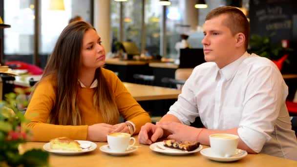 Happy couple suddenly laugh in cafe - coffee and cake