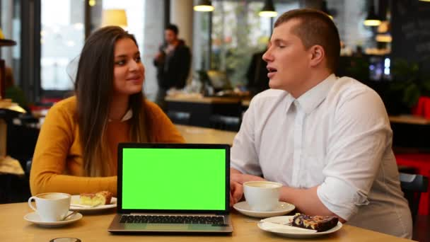 Happy couple talk in cafe - coffee and cake - computer (notebook) green screen