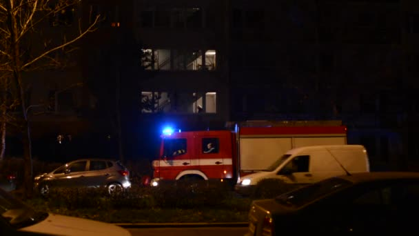Fire engine (car) in front of building (flats)