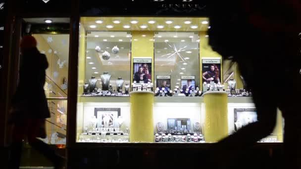 Jewelry shop (shop window) on urban street - walking people