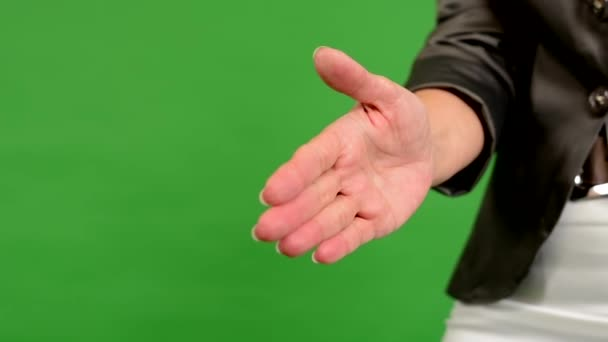 Business middle aged woman gives a hand in greeting - green screen - studio - closeup