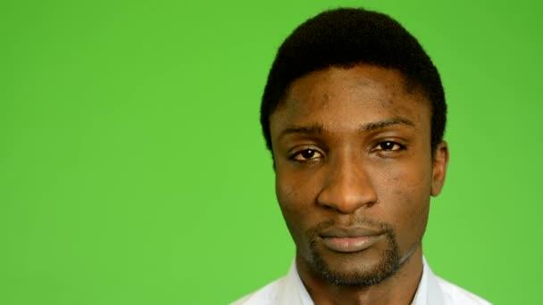 Young handsome unhappy black man look to camera - green screen - studio - closeup