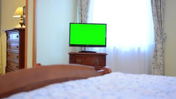 TV(television) - green screen - bedroom (hotel room)