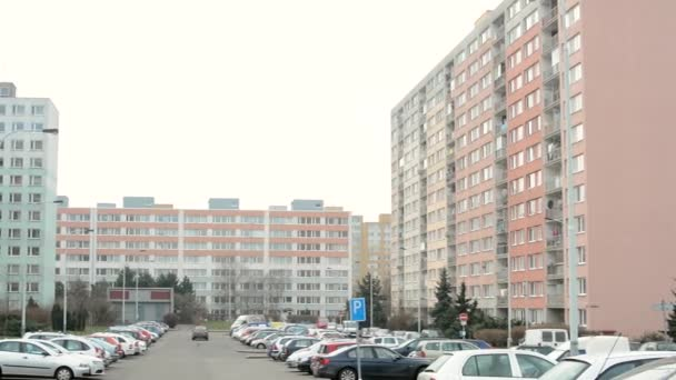 Housing estate (high rise block of flats) with nature and car park - people