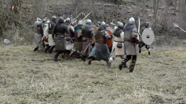 Medieval battle - war - soldiers walking in row and fight