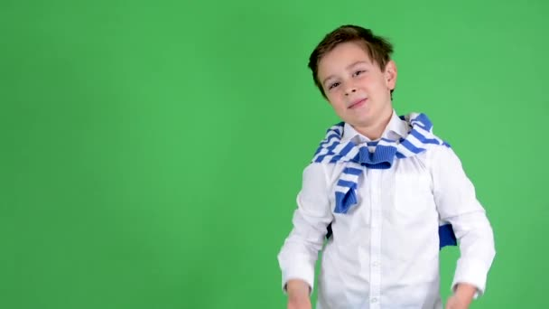 Young handsome child boy invites people - green screen - studio