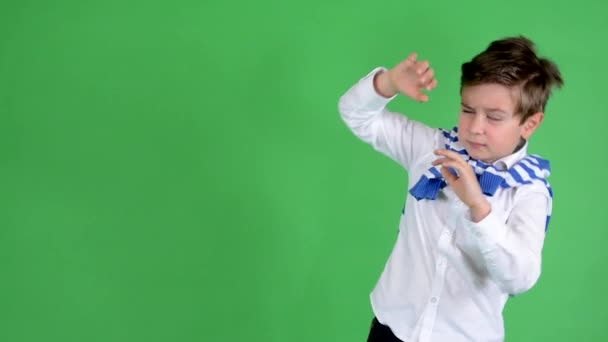 Young handsome child boy is scared (defends) - green screen - studio